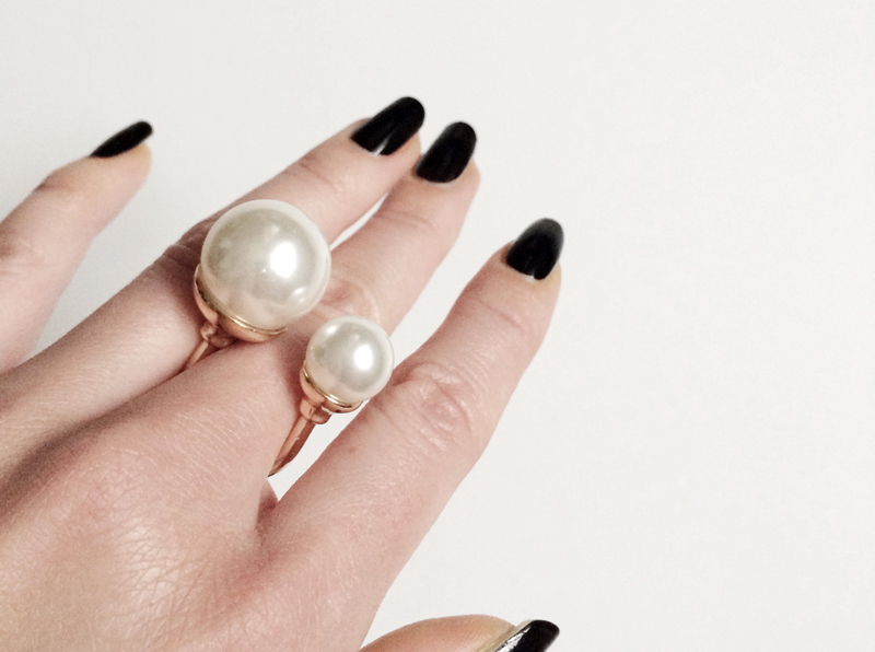beauty: black polish and pearl ring