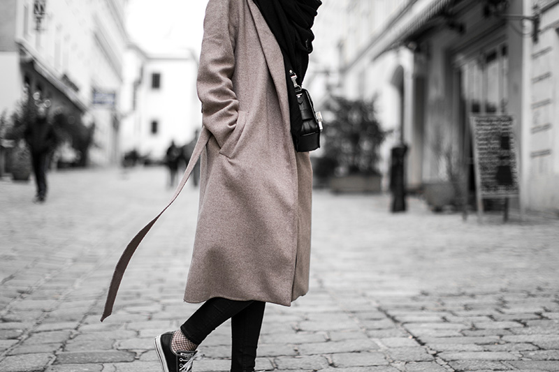 brown coat, converse and fishnets
