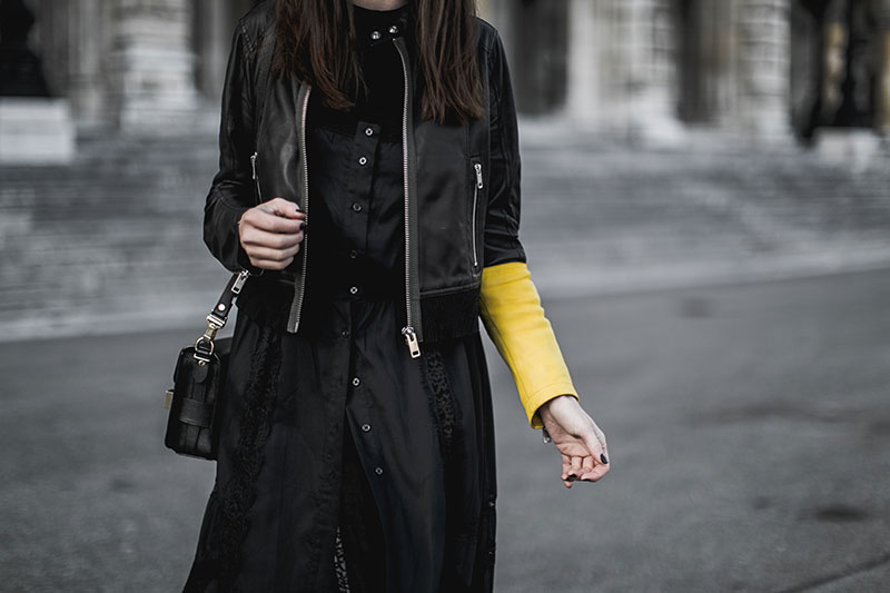 black leather jacket yellow sleeve worry about it later streetstyle vienna
