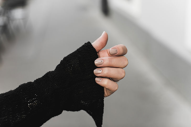 Nude and black dots manicure